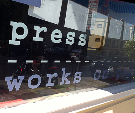 Press:Works on Paper, with the work of Toby Millman hanging in the window...