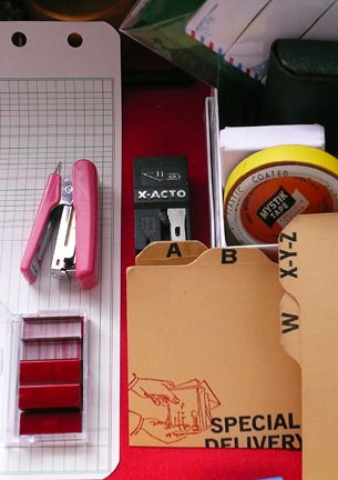 i didn't -really- need that pink stapler. but i DID need the red staples...