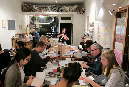 happy people, binding books! (photo courtesy of Nick Sarno)