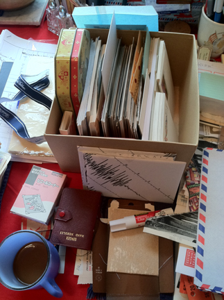 coffee, airmail envelopes, and glue sticks: ready to settle down to work!