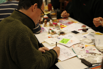Mark Bloch puts the finishing touches on an envelope...