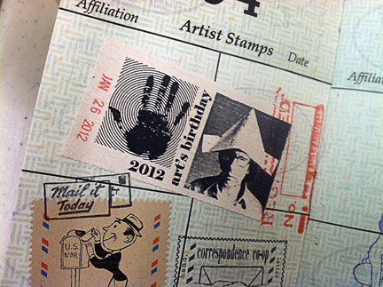 SF Co-op passport page, filled with artistamps!