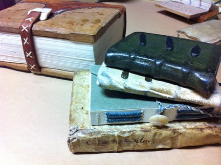 "a group of books created in the ""Medieval Pocketbook"" class taught at Jody Alexander's Wishi Washi Studio in Santa Cruz"